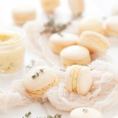 Orange Thyme Macarons are crisp on the outside, soft & chewy on the inside & they come laden with a generous scoop of rich, buttery filling.