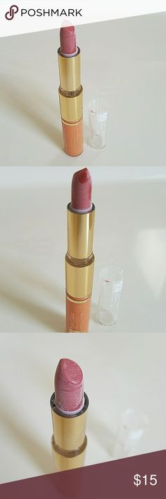 Estee Lauder Lip Gloss and Lipstick Duo Beautiful brand new without price tag Estee Lauder Lip Gloss and Lipstick Duo. Ripe Papaya Lipstick: .04oz. Peach Sizzle Shimmer Lip Gloss: 4.6ml. Part of extras that came with my purchase. Never used and don't need it. Any applicable original labels still on item though. It did not come in a particular box or case. Estee Lauder Makeup