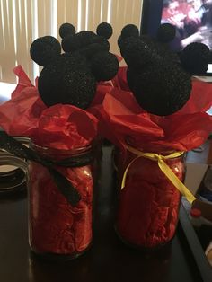 Mickey Mouse Center Pieces for my Baby Shower  I made these with styrofoam balls and wooden sticks that I spray painted (used toothpicks to assemble ears), used tissue paper to fill mason jars, and ribbon to tie around the rims. #MickeyMouse #BabyShower #CenterPiece