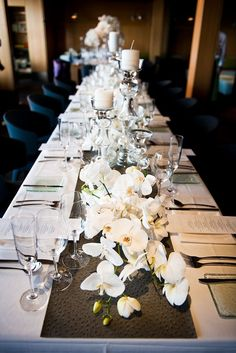 Long Table with Orchids & Candles - LOVE! @Carol Evans... idk what your thinking for tables... but this is PRETTY! The runner with the orchids laying on top & random candles... So nice :-)