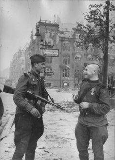 Cheerful Soviet soldiers in the streets of Berlin after their victory over Nazi Germany in 1945.