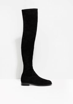 Cleancut yet statement-making, these fitted over-the-knee boots are crafted from stretchy suede in deep powder black.