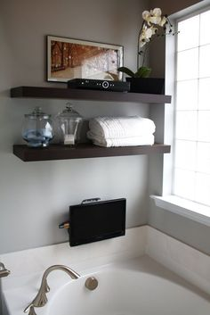Laundry in bathroom, bathroom shelves, master bathroom, master bath r Vanity Shelves, Bathroom Shelves, Small Bathroom, Bathroom Ideas, Bathroom Storage, Bath Tub Decor Ideas, Bathroom Remodeling, Half Bathrooms, Restroom Ideas