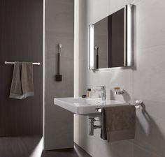 Losse wastafel met designsifon en spiegel met geïntegreerde verlichting