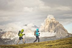 Couple hiking in the rain, Italian Dolomites    Hannes Pranstaller and Geddy Knapp hiking in the Italian Dolomites on a cloudy and rainy day. The Tre Cime di Lavaredo are in the background.