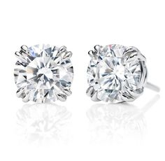 Harry Winston Round Brilliant Earstuds    2 round brilliant diamonds, 2.03 total carats; platinum setting.