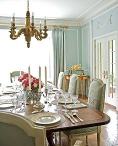 FRENCH STYLE IN THE DINING ROOM This dining room features some formal-flourish France -- pilasters, ceiling details, a Versailles-style parq...
