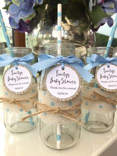 Personalised baby shower glass milk bottles in a baby blue theme. Fill with sweets, treats or soda for the perfect gift for your guests.