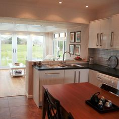 Stunningly renovated open-plan kitchen diner suitable for all those precious family times - sleek white kitchen cupboards and tiled splash-backs resulting in a modern feel and comfortable environment in the home!