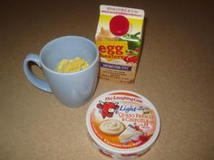 Scrambled Eggs in a mug with laughing cow cheese