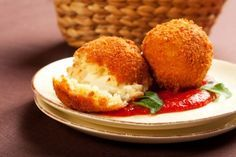 Italian Sicilian Arancini...fried rice balls filled with meat and melted cheese!!