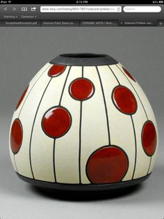 Red and white vase with dot pattern. Cut out dots vase. Red and white vase with dot pattern.