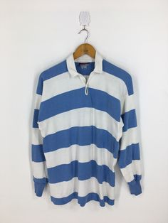 Excited to share this item from my #etsy shop: CANTERBURY New Zealand Medium Striped Rugby Shirt Vintage All Black Canterbury of New Zealand Striped Blue/White Polo Rugby Shirt Size M #clothing #men #shirt #newzealandrugby #canterburyrugby #australiarugby #polorugbyshirt #vintageallblacks #allblackshaka