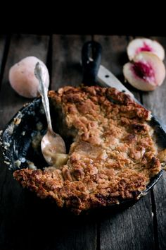 What says comfort better than a good Peach Crumble baked in grandma's black iron skillet.  Looks yummy.