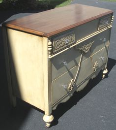 Angled view of this old dresser with stained top and painted/antiqued body. One of my favorite pieces! I am envious of the person that bought her :)