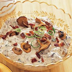 Mushroom-and-Bacon Dip Provided By:       Loaded with wild mushrooms and smoky, salty bacon, this creamy cream-cheese dip is a favored pick for MVP of the snack table.