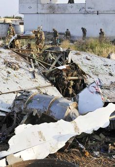 Pakistani soldiers search at the site in Hussain Abad after a Bhoja Air Boeing 737 plane crashed on the outskirts of Islamabad on April 21, 2012.