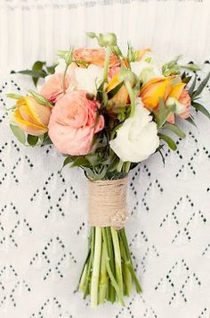 Wedding Bouquet in peach, coral and white. Tulips, freesia and ranunculus