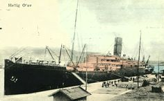 """Skipsmotiv D/S """"HELLIG OLAV"""". Skipet ved kai, farget overbygg  Utg A/S Bricksen & CO Brukt 1913"""