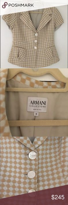 """Armani Collezioni Cream & Beige S/S Blazer Fabulous short sleeved blazer from Armani Collezioni. Beige and cream allover diamond design. Low v neck - would wear with a camisole, pouch pockets, pearlized button front closure, ruffled back, fully lined. Size 10.  Worn 1x!! 19"""" pit to pit,16"""" across waist, 16"""" shoulder to shoulder, 23"""" long. Made in Italy, Dry clean only. 64% acetate, 23% cotton, 13% silk. Thanks for looking!!  No trades. Price firm. Armani Collezioni Jackets & Coats Blazers"""
