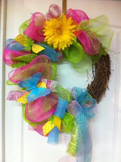 Deco Mesh wreath for Spring made with a grapevine wreath