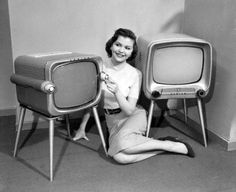 1955 Miss Illinois, Dianne Daniggelis, introducing the new portable 45-lb. Zenith televisions, which use a shorter television tube than prior models, have a 17-inch screen with side grips to store the antenna and power cord.
