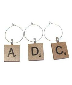 Scrabble Wine Charms: Family game night meets wine-tasting party with these creative charms. Choose any four letters that you'd like (but might we suggest W-I-N-E?).