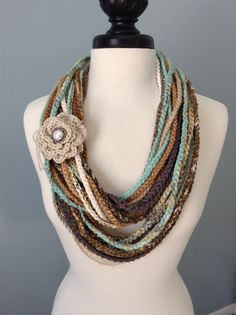 BLENDED TEXTURES AND COLORS....Single crocheted infinity necklace scarf in multi colors. Several different types of yarn and ribbons have been