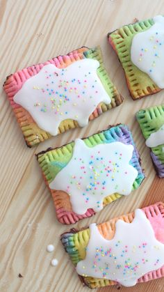 Recipe with video instructions: Multicolored jam-filled pastries should be a regular part of breakfast. Ingredients: Pop Tart Dough:, 2 ½ cups all-purpose flour, 1 tsp salt, 1 tsp sugar, 1 cup cold unsalted butter, cut into cubes, ¼ - ½ cup cold water, pink, orange, yellow, green, blue and purple food coloring, Filling:, any jam of your choice, Glaze:, 3 tbsp whipping cream, ½ tsp vanilla extract, ½ cup confectioner's sugar, rainbow sprinkles