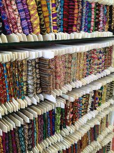 El blog de Georgina: Estamos aquí.... Diy Fabric Jewellery, Textile Jewelry, Bridal Boutique Interior, Clothing Store Displays, Burgundy Bag, Fabric Display, E Craft, Sewing Material, Bead Shop