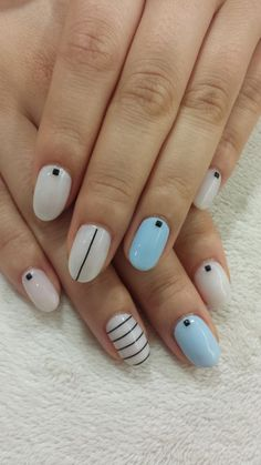 Love simple and clean nail look? These artistic nails will fit you perfectly while going to school or work. Laced with pale and plain colors, the white shades are then lined by single thin dark lines to emphasize the simple yet elegant design topped with small dark beads.