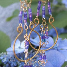 Purpley-blue beaded earrings with gold wire filigrees by contains_caffeine, via Flickr