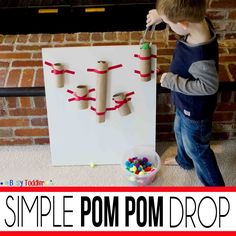 Create a simple pom pom drop using paper tubes. Toddlers will love this easy homemade activity that can be set up in under 5 minutes but tots will love!