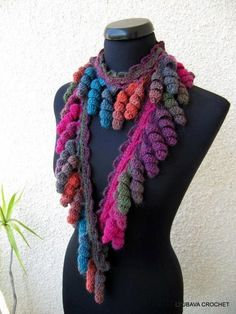 Easy scarf - This is a lot like one of my scarves I designed & had published in 2005. I had the curliques on both edges though. Love these colors.