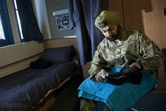 Guardsman Jatenderpal Singh Bhullar the first Guardsman to wear a turban while guarding the Queen, is pictured polishing his boots.