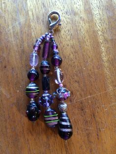 This chunky beaded zipper pull will add some fun and funky flair to any coat or jacket.