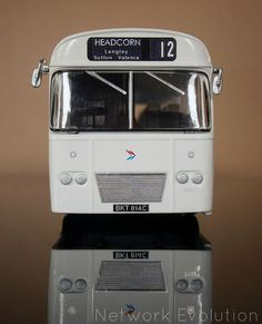 1965 AEC Reliance with Weymann dual purpose body finished in National coach white livery.  Route 12 to Headcorn blinds are carried.  This is the original version of the model from 2012.   The model features Acrylic clearcoat with gunmetal chassis.  Wheels are finished in NBC light grey with trims fitted at the rear.  EFE 1:76 code 3, full airbrush respray from bare-metal.  networkevolution.co.uk