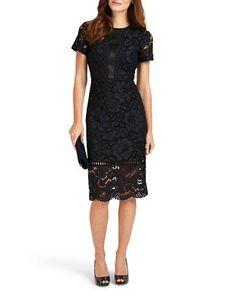 """<ul><li>Floral lace embroidery styles this scallop edged dress</li><li>High neckline</li><li>Short sleeves</li><li>Scalloped hem</li><li>Concealed back zip closure</li><li>About 44"""" from shoulder to hem</li><li>Nylon/viscose/cotton</li><li>Dry clean</li><li>Imported</li></ul>"""