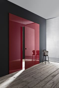 interior details - colour and material contrasts - gloss red, matte black and bare wood
