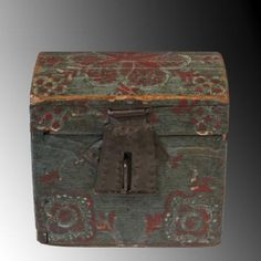 Lancaster County, PA, ca. 1800-1840.OF JUST THREE DOZEN DOME TOP BOXES ATTRIBUTED TO THE COMPASS ARTIST, THIS BOX IS THE SMALLEST AT UNDER FOUR INCHES.Tiny cut nails attach the base and hand-planed lid. Decorations laid out and scribed by compass before painting. Distinctive tinned sheet iron hinges, and punchwork-decorated escutcheon plate and fan-shaped hasp are characteristic of this maker and original. Painted with a Prussian blue ground, the scribe lines highlighted with