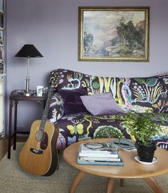 Neko Case's living room: An Anthropologie sofa, upholstered in Josef Frank fabric, and a Heywood-Wakefield coffee table furnish the living room, painted in Behr's Elm Bark.    Read more: Neko Case Vermont Farmhouse - Neko Case House Tour - Country Living