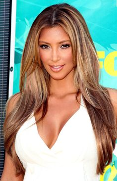 i so wish my hair was as long as kim's is.