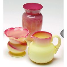 """Pairpoint Burmese vase, small shouldered form, 3""""w x 5.5""""h; with a vase, small waisted form with ruffled rim, 3""""w x 3""""h; with a pitcher, diamond quilt design, 4""""w x 4""""h, all in rose and custard glass"""