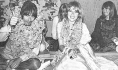 George Harrison and Pattie Boyd in India. Cynthia Lennon in the background