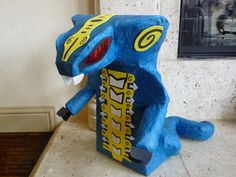 Ninjago Inspired Blue Snake Pinata by HelpfulThings on Etsy, $40.00    tomas want's a lego party and this is the piñata he is going to have.