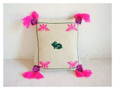 Wixárika/Huichol hand-embroidered wool pillow with Rabbit design and pom poms (( Mexchic & Tawexikta Embroidery Project )) via Etsy