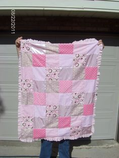 This is a crib sized baby blanket that I made for my newest granddaughter.  I've used this block pattern (my design & layout) on another quilt I made for another granddaughter (using animal prints).  I also have down-sized and made baby car seat covers.