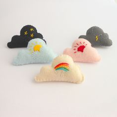 Rain Cloud brooch, felt and stuffed pin. €8.00, via Etsy.