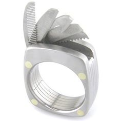The Swiss Army Knife of rings - It features a bottle opener,  straight and serrated blades, saw, and a tiny comb.  All the tools are somehow housed in just a 9mm wide band that will be custom made to your ring size.