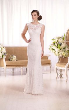 Stunning Essense of Australia's patterned lace wedding gown features lace over an Imperial crepe sheath gown & the bodice boasts an illusion collar.